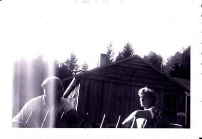Alex and Clara Laing at house on Mud Bay, 1953