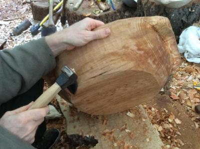 Carving the outside of an alder bowl with an adze.
